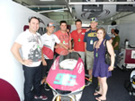 Ant West with team experienece guests at Sepang