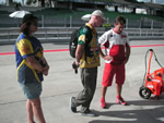 Customers chat with Rossi mechanic Alex Briggs on Sepang pit row